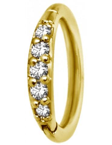 anneau doré avec une partie cristal